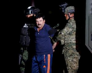 "Joaquin ""El Chapo"" Guzman is escorted by soldiers in Mexico City in January 2016. Photo: Reuters"