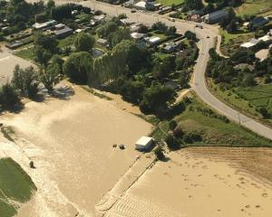 The Manuherikia River floods the outskirts of the Ophir township. Photo: Central Otago District...