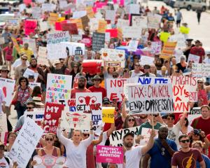 People march to the Alabama State Capitol in May in protest against the state's new abortion law,...