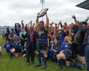Invercargill Blues captain Michael Peterson lifts the Galbraith Shield after his side beat Star...