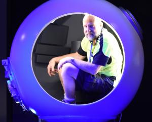 Otago museum production and projects officer Garry Gibson fits snuggly in a replica diving...