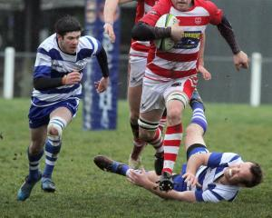 Clutha co-captain Simon Grant muscles his way over a Heriot tackler in the side's semifinal win...