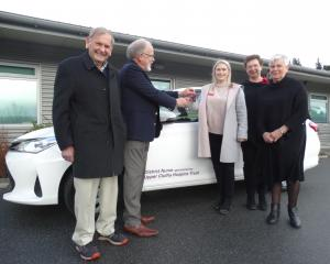 Celebrating the handover of keys for a new vehicle to help deliver palliative services in the...