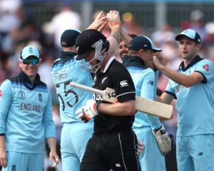 James Neesham looks dejected as he walks off after losing his wicket as England's Mark Wood...