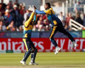 Sri Lanka's Angelo Mathews celebrates after taking the wicket of West Indies' Nicholas Pooran....