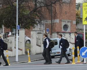 "Otago Boys' High School pupils yesterday afternoon walk across a ""safe crossing'' which is part..."