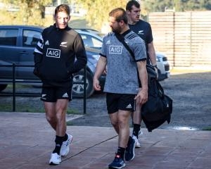 Beauden Barrett (left) and Dane Coles walk to All Blacks practice followed by Brodie Retallick....