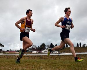 Daniel Balchin (left) and Janus Staufenberg battle it out over the back end of the Otago cross...
