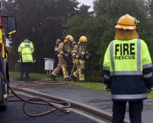 Firefighters attend the scene of a house fire on Panmure Ave in Calton Hill this afternoon. Photo...