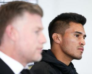 New signing Ulises Davila (R) and coach Ufuk Talay speak to media during a Phoenix press...