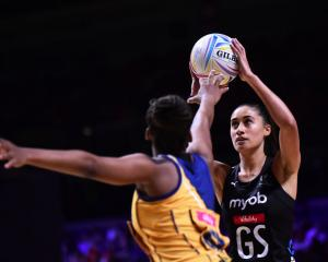 Maria Folau lines up a shot at goal for the Silver Ferns against Barbados. Photo: Getty