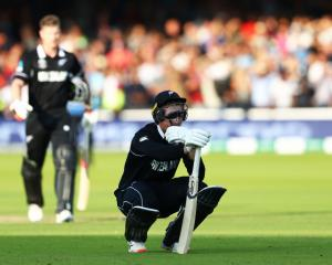 Martin Guptill reacts as he is run out on the final ball of the Super Over by Jos Buttler. Photo:...