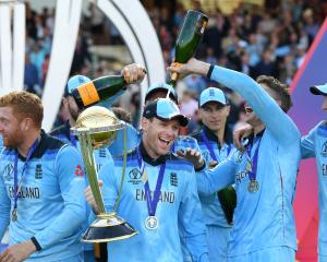 England Captain Eion Morgan (with trophy) admits to feeling 'troubled' by the manner of his team...