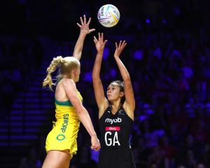 Australian defender Jo Weston tries to stop Silver Ferns shooter Ameliaranne Ekenasio from taking...