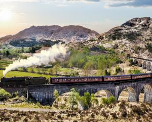 The Jacobite steam train crosses the Glenfinnan Railway Viaduct on the West Highland Line. Photo:...