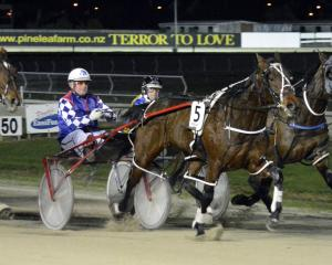 Gimmefiveminutesmore holds off The Night Hawk (inner) and Four Starzzz Shiraz to win the Forbury...