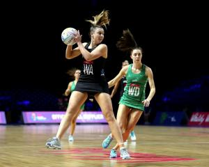 Gina Crampton catches the ball for the Silver Ferns during last night's win over Northern Ireland...