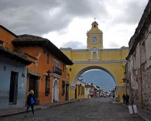 People walk in the streets of Antigua, Guatemala's old capital. Photo: JOHAN ORDONEZ/AFP