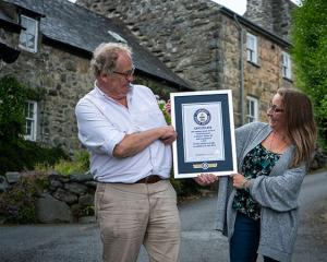 Harlech residents Gwyn Headley and Sarah Badham admire the certificate from the Guinness World...