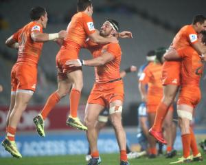 Nicolas Sanchez and Javier Ortega Desio of the Jaguares celebrate a win. Photo: Getty Images