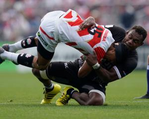 William Tupou of Japan is tackled by Leone Nakarawa of Fiji during the Pacific Nations Cup match...