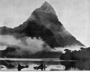Early morning mists surround Mitre Peak, Milford Sound. — Otago Witness, 16.7.1919   COPIES OF...