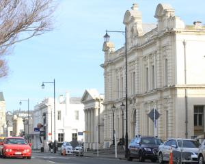 The Oamaru Opera House, right, still carries $3,406,793 in debt after the Lower Thames St...