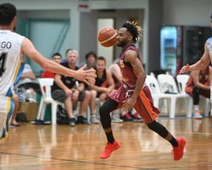 Southland Sharks guard Tinashe Matambanadzo attacks in transition as Otago forwards Tai Porima...