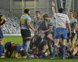 University players are thrilled after Angus Williams (centre) scores the match-winning  try...