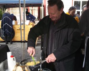 Jeff Weston, of West Melton, cooks up some truffled eggs at the Christchurch Farmers' Market...