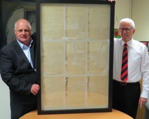 Waimakariri Irrigation Ltd chief executive Brent Walton (left) presents an 1894 report...