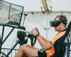 Aorangi Young Farmer of the Year representative Alan Harvey uses a virtual reality simulator as...