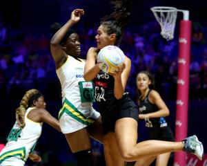 Silver Ferns' goal attack Ameliaranne Ekenasio looks to pass around ZImbabwe's Adelaide Muskwe in...