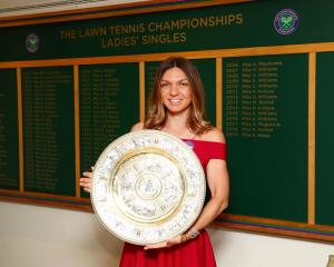 Simona Halep after winning the Wimbledon singles title. Photo: Getty Images