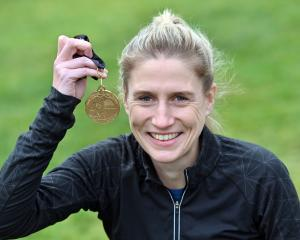 Sonya Cameron is  all smiles back home with her winner's medal from the Wellington Marathon....