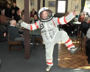 "Donning his homemade ""spacesuit"" Dunedin man Keith Dickson found a novel way to mark the 50th..."
