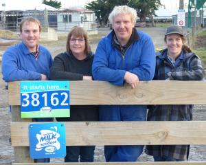 Producing ``grade free'' milk for 14 years are the Morrison family, from left, Brendan, Marie,...