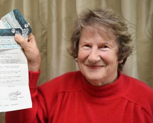 Holding the letter from Pan Am Airways she received 50 years ago confirming her place on the...