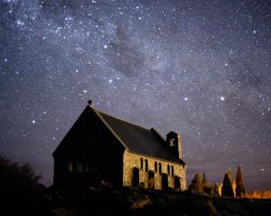 The Church of the Good Shepherd at Lake Tekapo with Southern Cross in the background. Photo by...