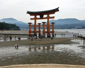 Torri Gate at the entrance to Miyajima Island marks the transition from the human to the...