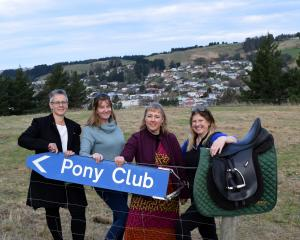 Saddleview Pony Club members celebrate their new grounds (from left) secretary Sharleen Warren,...
