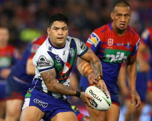 Issac Luke runs the ball during the match between the Newcastle Knights and the New Zealand...