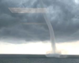 A waterspout is seen on Lake Pontchartrain off New Orleans, Louisiana. Photo: Bryon Callahan via...