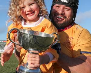 North Otago prop Ralph Darling celebrates with daughter Manaia and the Phil Gard Memorial...