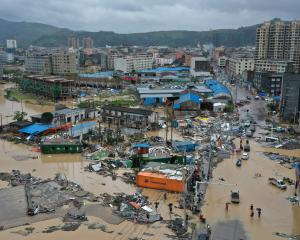 Dajing town is seen damaged and partially submerged in floodwaters in the aftermath of Typhoon...