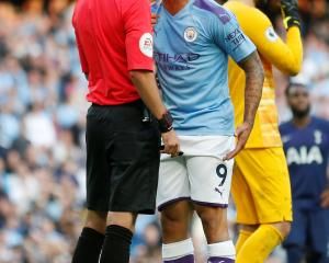 Gabriel Jesus of Manchester City angrily remonstrates with referee Michael Oliver after VAR ruled...