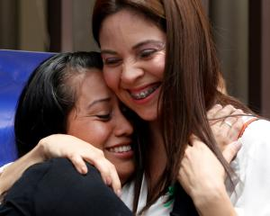 Evelyn Hernandez (L) embraces her lawyer Bertha Deleon after the hearing in Ciudad Delgado, El...