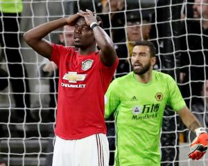 Manchester United's Paul Pogba reacts after his penalty is saved by Wolverhampton Wanderers' Rui...