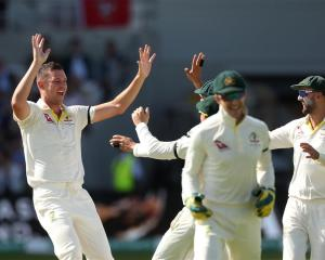 Australia's Josh Hazlewood celebrates taking the wicket of England's Joe Root. Photo: Reuters