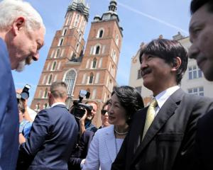 It is not known how Krakow Mayor Jacek Majchrowski greeted Japan's Crown Prince Akishino and...